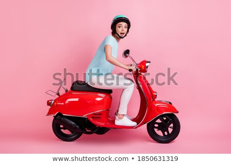 Girl in red shirt riding on scooter on white background Stock photo © bluering
