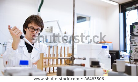 female researcher/chemistry student carrying out experiments in a lab Stock photo © lightpoet