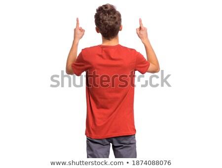 boy touching something with his finger isolated Stock photo © vkraskouski