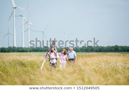 Woman in front of a wind farm Stock photo © photography33