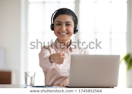 Customer service operator holding mic Stock photo © stockyimages