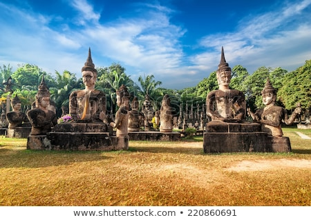 buddhist religious figures on temple in laos Stock photo © travelphotography