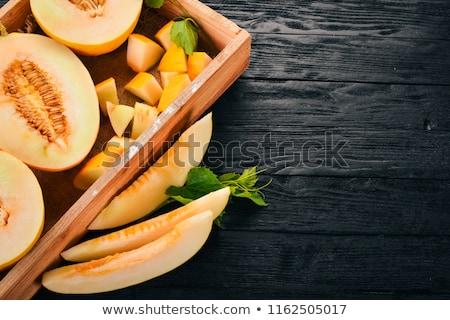 Jaune melon tranches blanche sweet fruits Photo stock © Gbuglok