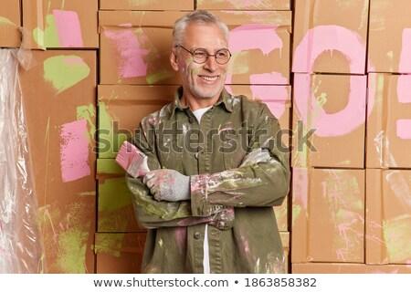Grey-haired decorator thinking Stock photo © photography33