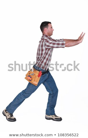 Rzemieślnik popychanie coś działalności domu pracy Zdjęcia stock © photography33