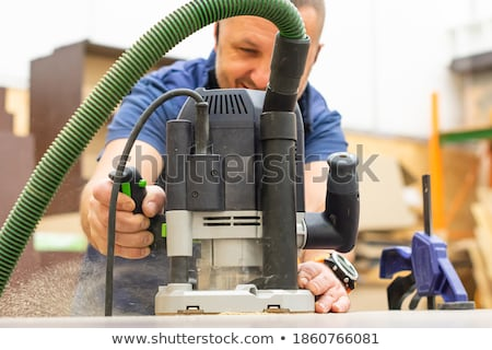 craftsman working with an electric cutter stock photo © photography33