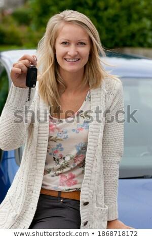 Blonde woman holding her waist while posing stock photo © wavebreak_media
