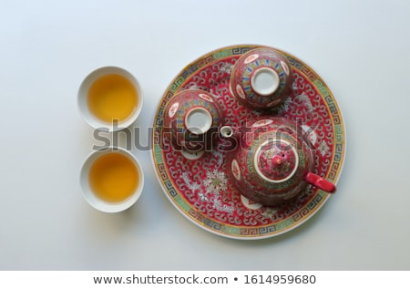 Fine china cup and saucer filled  isolated on white Stock photo © oly5