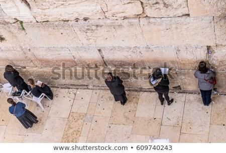 praying above the western wall stock photo © eldadcarin