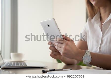 fiatal · üzletasszony · mobiltelefon · szervező · áll · irodaház - stock fotó © vlad_star