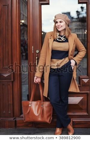 fashionable lady wearing overcoat Stock photo © get4net