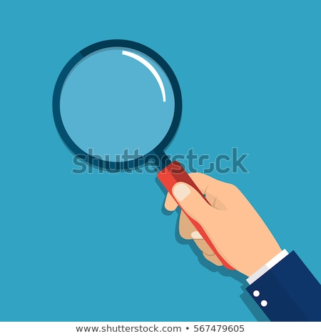 Hand holding magnifying glass Stock photo © stevanovicigor