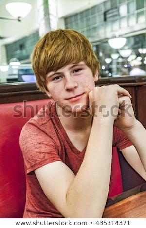 Mosolyog fiú éjszaka vacsora vár érzelem Stock fotó © meinzahn