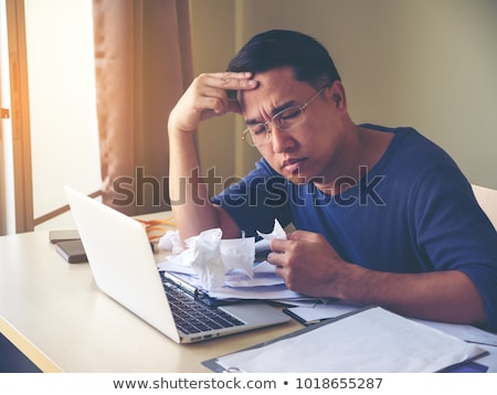 Middle aged man having headache Stock photo © stockyimages
