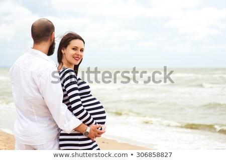 女性 ビーチ 帽子 妊婦 座って 海 ストックフォト © compuinfoto