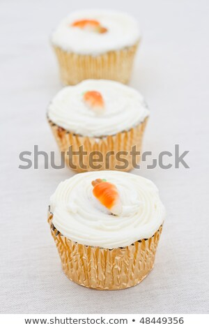 Three small carrot cakes in a line Stock photo © raphotos