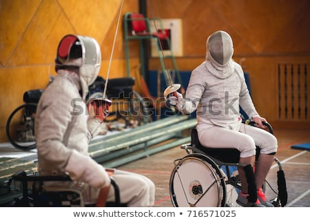 Stock photo: Children fencers and their  trainer
