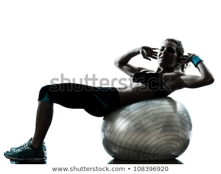 side view of a fit woman exercising on fitness ball stock photo © wavebreak_media