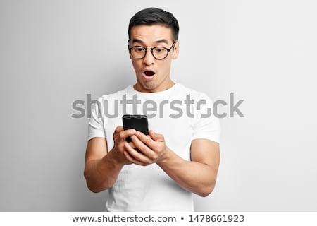 homem · de · negócios · leitura · sms · celular · bonito · feliz - foto stock © fuzzbones0