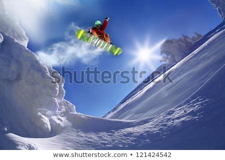 Boy jumping with snowboard Stock photo © adrenalina