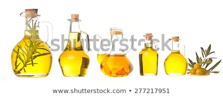 Garlic infused olive oil in a cruet Stock photo © marimorena
