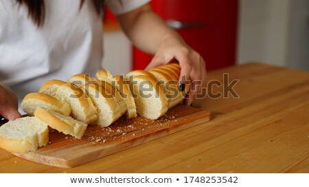 close up of white bread or baguette and knife stock photo © dolgachov