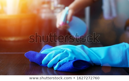 Spray pulizia mano giallo guanto Foto d'archivio © ssuaphoto