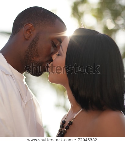 close up of african american young couple kissing outdoors in su stock photo © kzenon