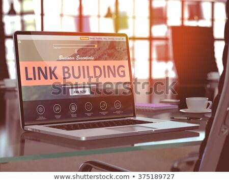 Laptop Bildschirm Link Gebäude modernen Arbeitsplatz Stock foto © tashatuvango