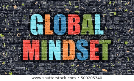 Global Mindset on Dark Brick Wall. Stock photo © tashatuvango