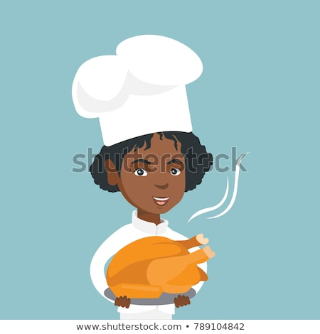 chief cooker holding roasted chicken stock photo © rastudio