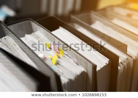 lap · iroda · mappák · üzletember · papír · csetepaté - stock fotó © ShawnHempel