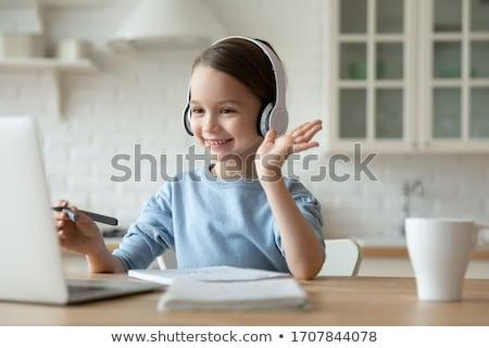 Gyerek lány laptop fejhallgató illusztráció kislány Stock fotó © lenm