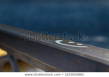 sign smile drawn on a stone wall, in blur Stock photo © TanaCh