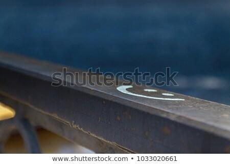 signo · sonrisa · muro · de · piedra · Blur · feliz - foto stock © TanaCh