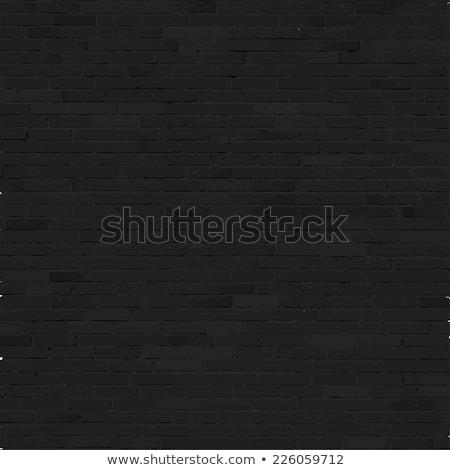 Pared de ladrillo negro alivio textura sombra construcción Foto stock © sidmay