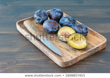 Plums in rustic wooden tray Stock photo © Melnyk
