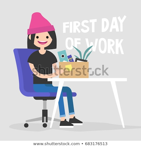 A young girl is sitting at a table in the office, holding a yellow marker in her hand. Before the gi Stock photo © Traimak