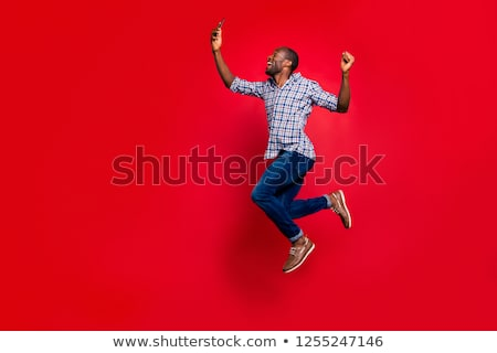 man wearing a shirt with red checkers walks to side Stock photo © feedough