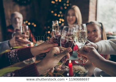 Lányok üveg pezsgő találkozik új év haj Stock fotó © ruslanshramko