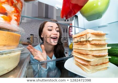 Foto d'archivio: Donna · guardando · sandwich · frigorifero · fame · open