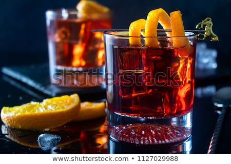 Negroni  cocktail with orange and ice Stock photo © furmanphoto