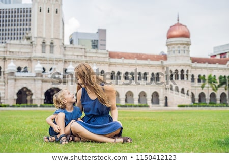 Mom and son on background of Merdeka square and Sultan Abdul Samad Building. Traveling with children Stock photo © galitskaya