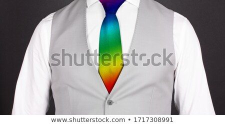 man tied up with a rainbow necktie