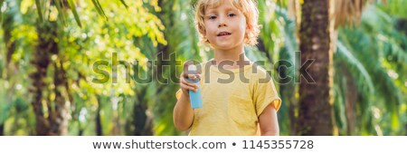 Boy spraying insect repellents on skin BANNER, long format Stock photo © galitskaya