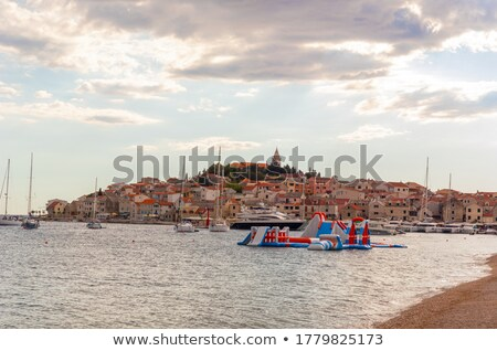 Adriatic tourist destination of Primosten archipelago sunset vie Stock photo © xbrchx