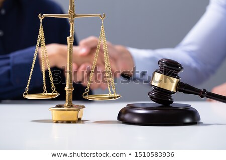 gavel and golden justice scale in front of shaking hands stock photo © andreypopov