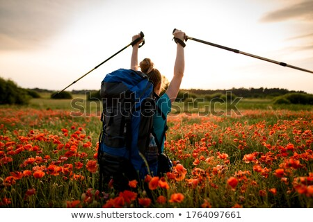 Cheerful hikers with backpacks and trekking sticks enjoying trip Stock photo © pressmaster