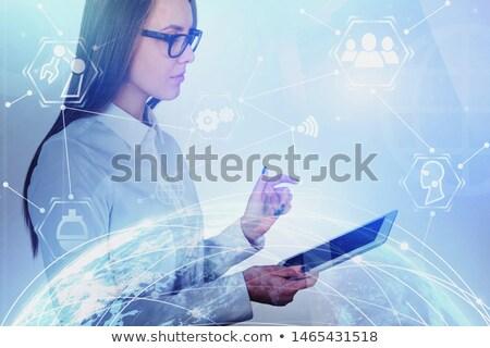 Vrouw aanraken hologram scherm kubus symbolen Stockfoto © ra2studio