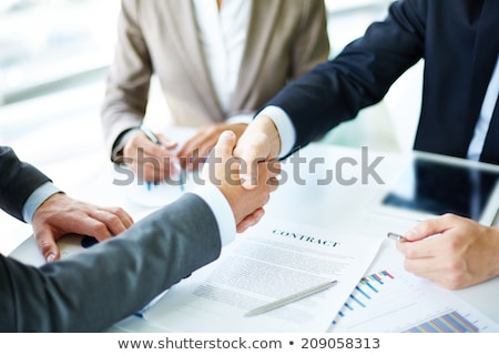 Cooperation strategy and handshake in contract agreement signature. Stock photo © cifotart